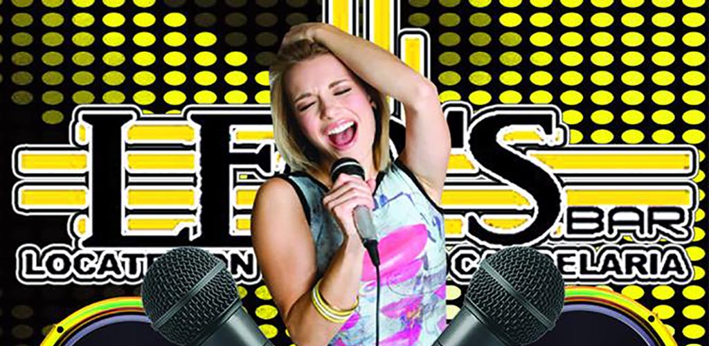 A woman singing karaoke at Leo's