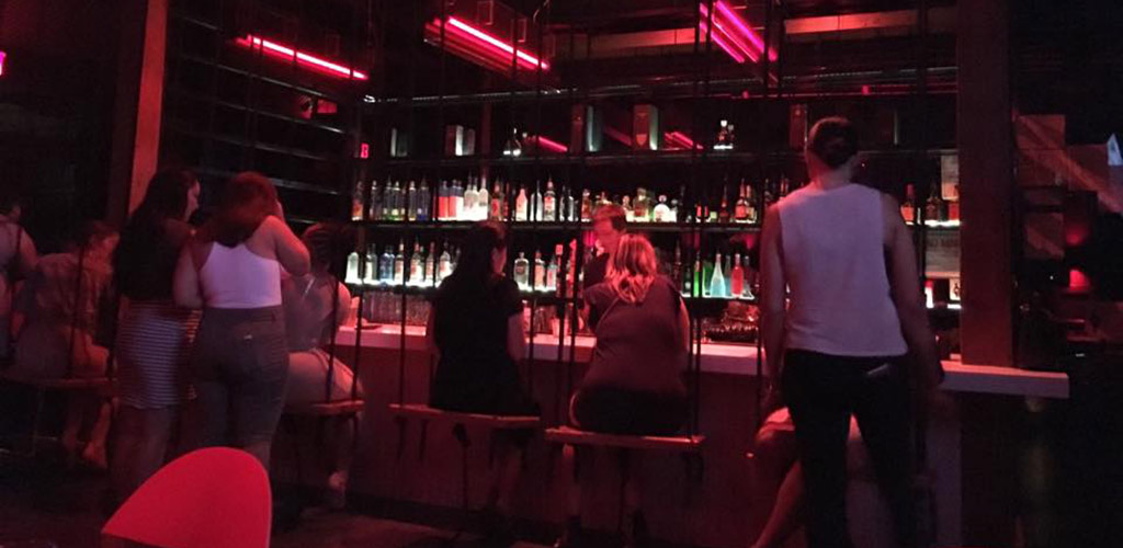 The bar at Mingle Lounge where the barstools are swings