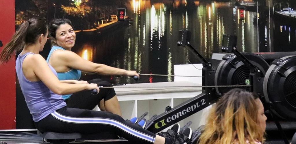 Two ladies on the rowing machine at Ferrino Sports