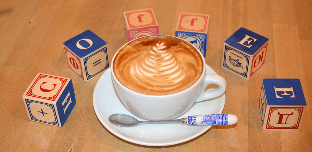 Latte art and alphabet blocks at Lucky Goat Coffeehouse