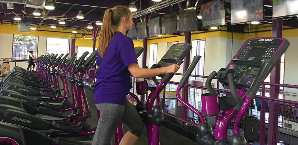 Wokring out on the elliptical machine at Planet Fitness