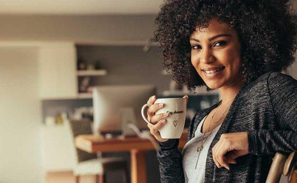 A beautiful girl enjoying some coffee at home