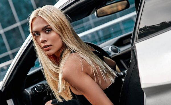 Beautiful woman in sports car