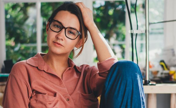 Girl in glasses lounging at home