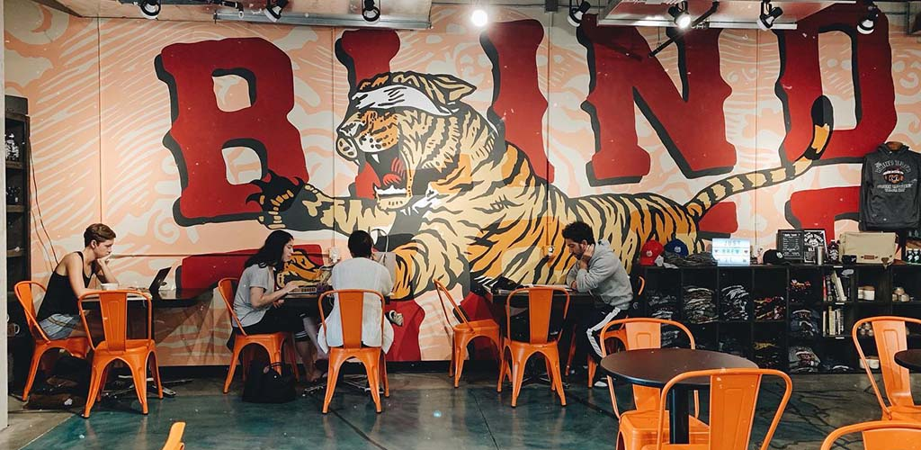 The Blind Tiger mural with a few patrons