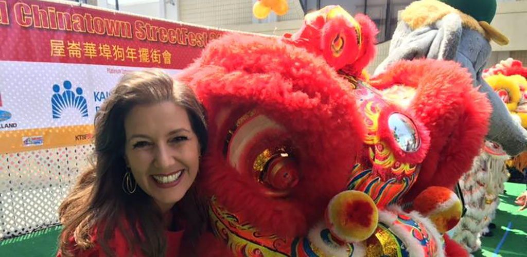 Posing beside the dragon figure at the Oakland Chinatown Street Festival