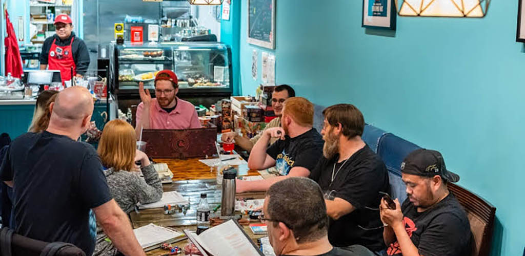 Friends enjoying board games at Dice and Beans