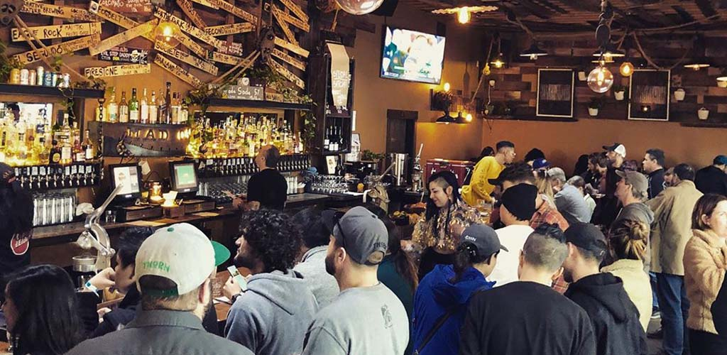 People crowding around the bar at Mad Oak