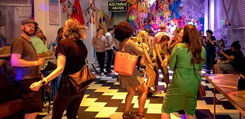 Partygoers dancing at Minneapolis Fringe
