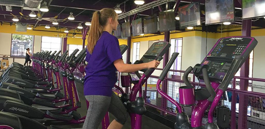 Working out on the elliptical at Planet Fitness