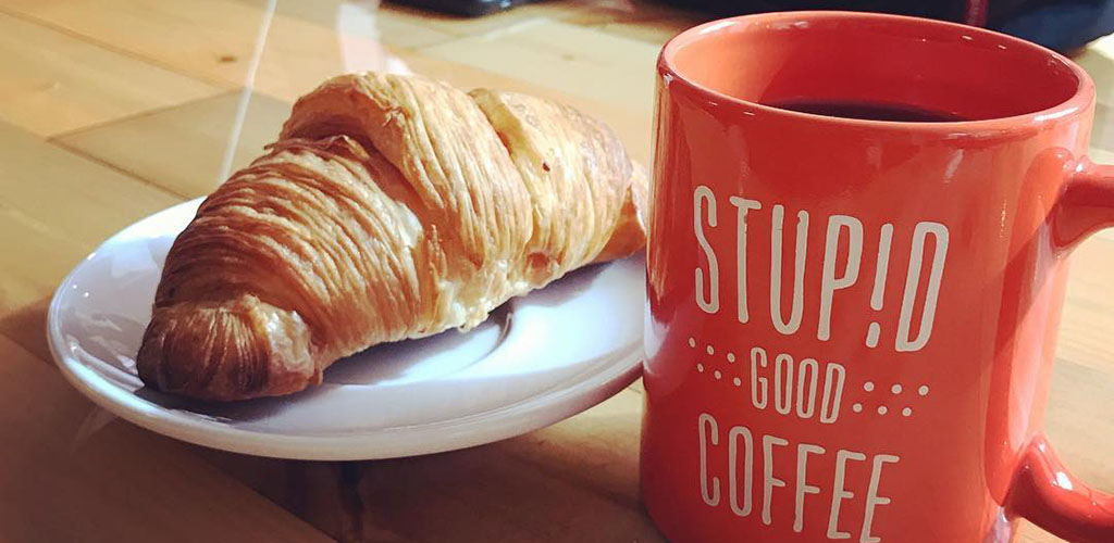 A croissant and coffee from Stupid Good Coffee