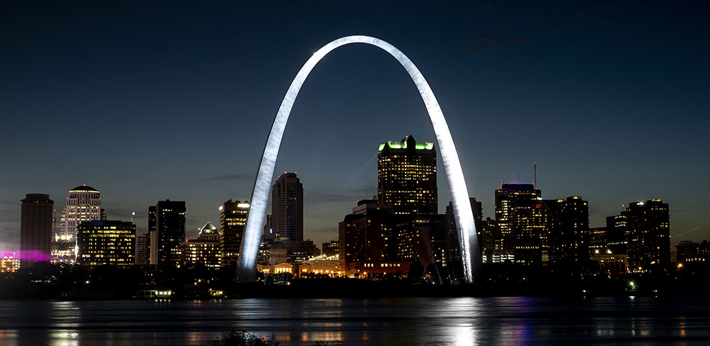 St Louis Gateway Arch brightly lit and shining at night