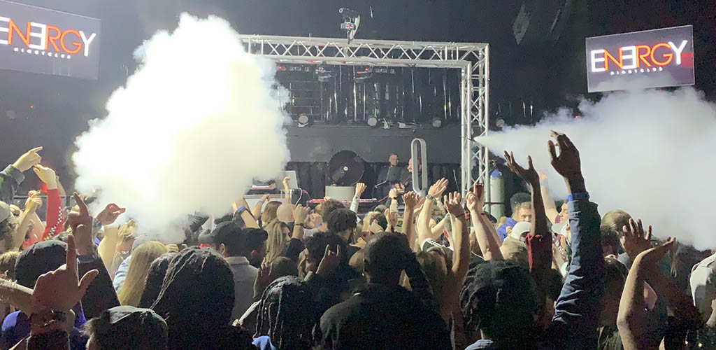 Packed concert in a Energy Nightclub with smoke machines