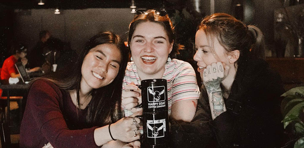 Girls having coffee at Happy Goat Coffee Co.