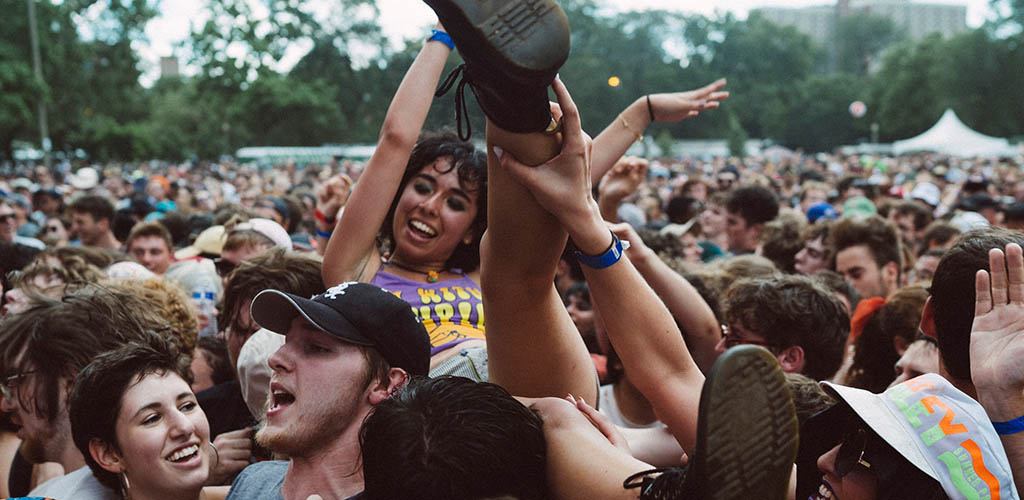 A girl being hoisted up by the audience at Pitchfork Music Festival