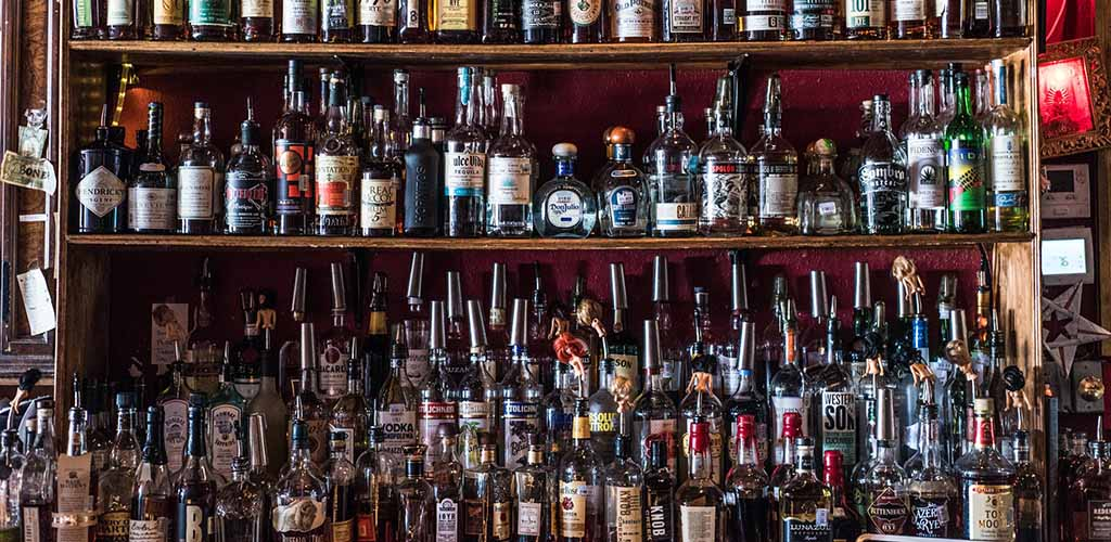 The liquor shelf at Poison Girl Cocktail Lounge