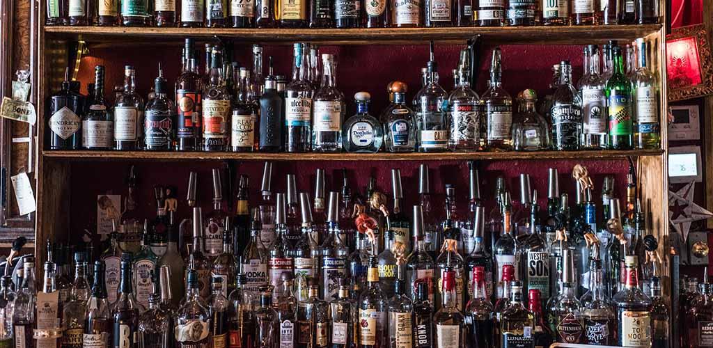 The liquor shelf at Poison Girl Cocktail Lounge