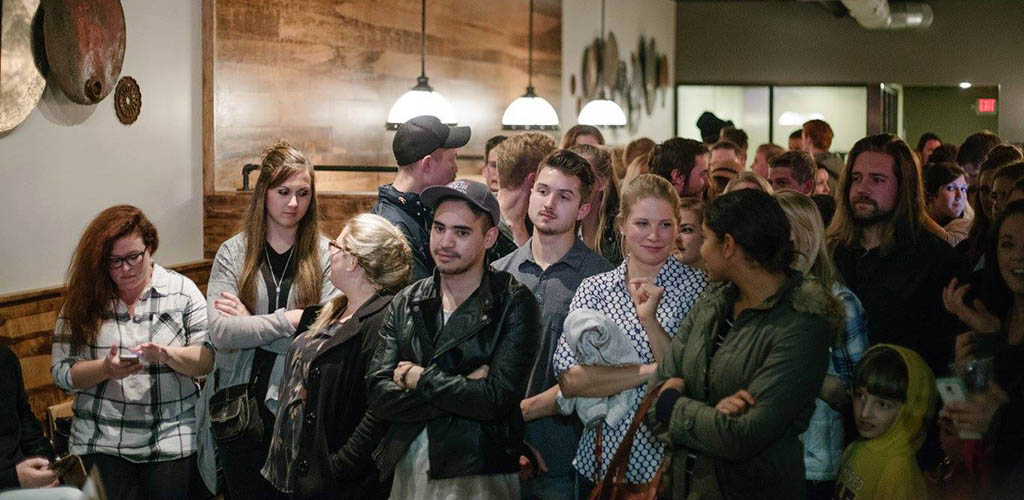 The audience during a live performance at Quixotic Coffee