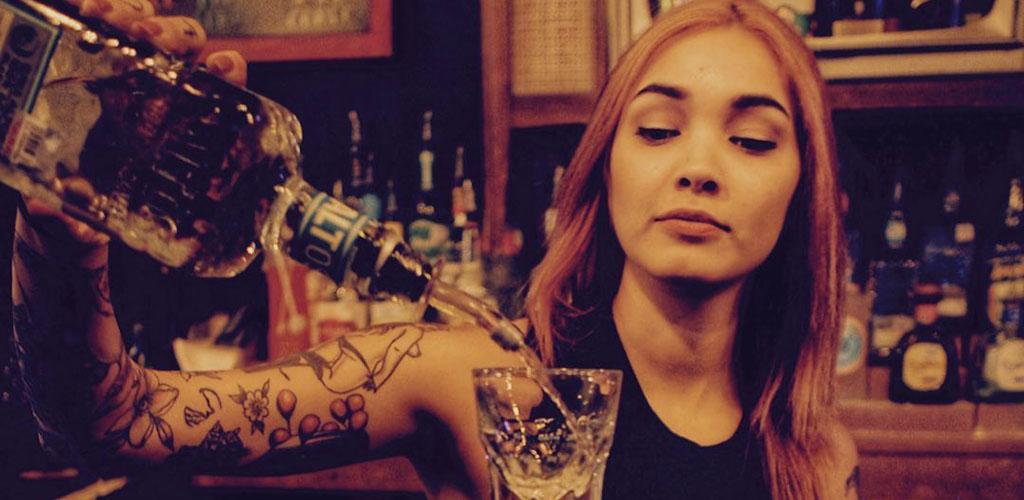 The hot bartender pouring a drink at The Bang Bang Bar
