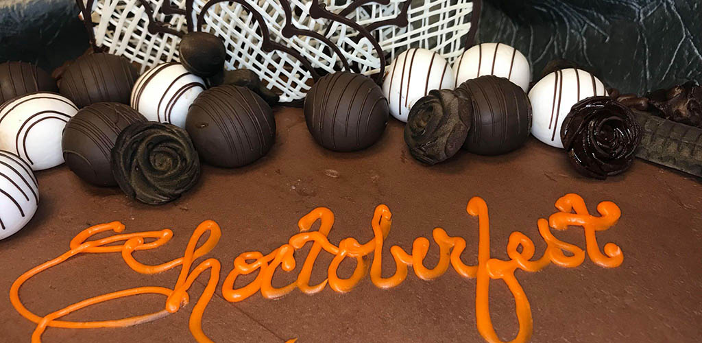 The Choctoberfest sign on a chocolate cake