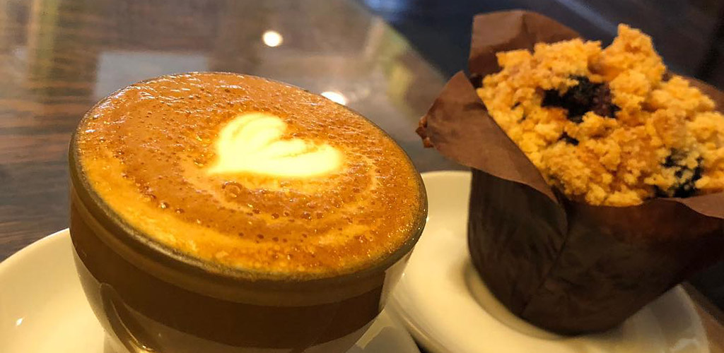 A latte and muffin from Big Dog Coffee Shop