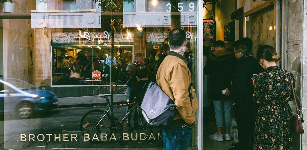 Exterior of Brother Baba Budan with people lined up
