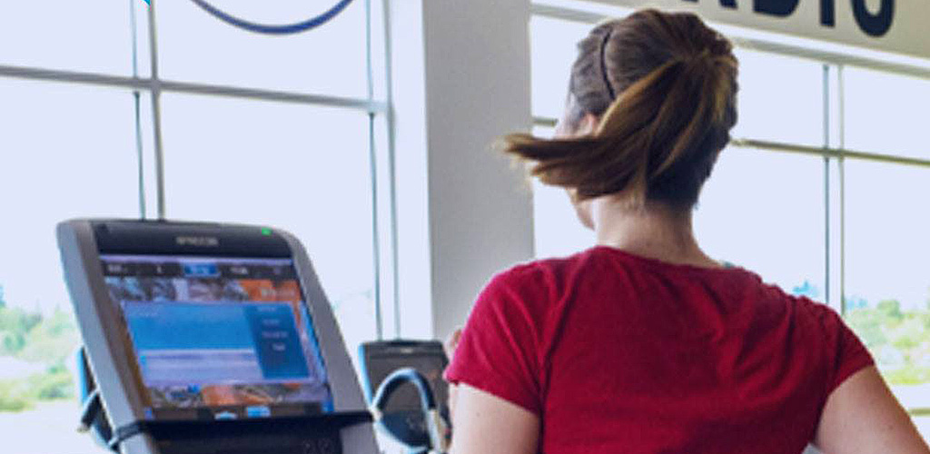 Working out on the treadmill at In-Shape Health Clubs
