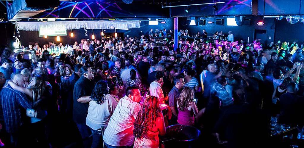 The huge dance floor of The Industry full of girls looking for hookups in San Antonio