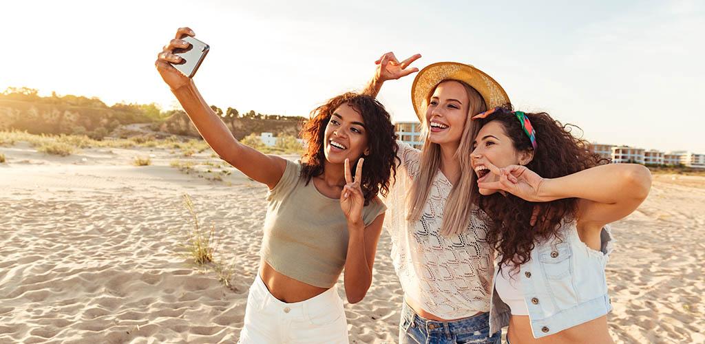 Hot Gold Coast girls taking selfies at the beach