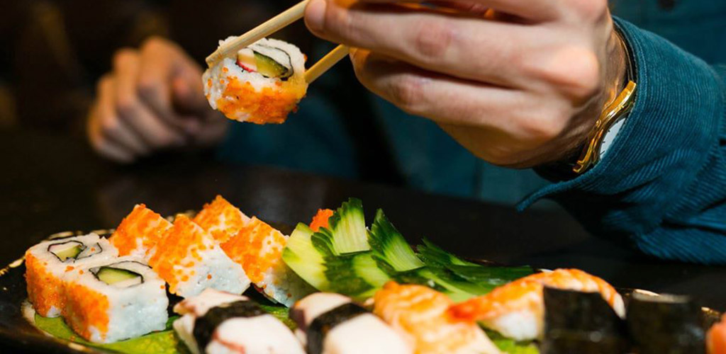 A sushi and sushi roll platter from Cosmo Restaurant