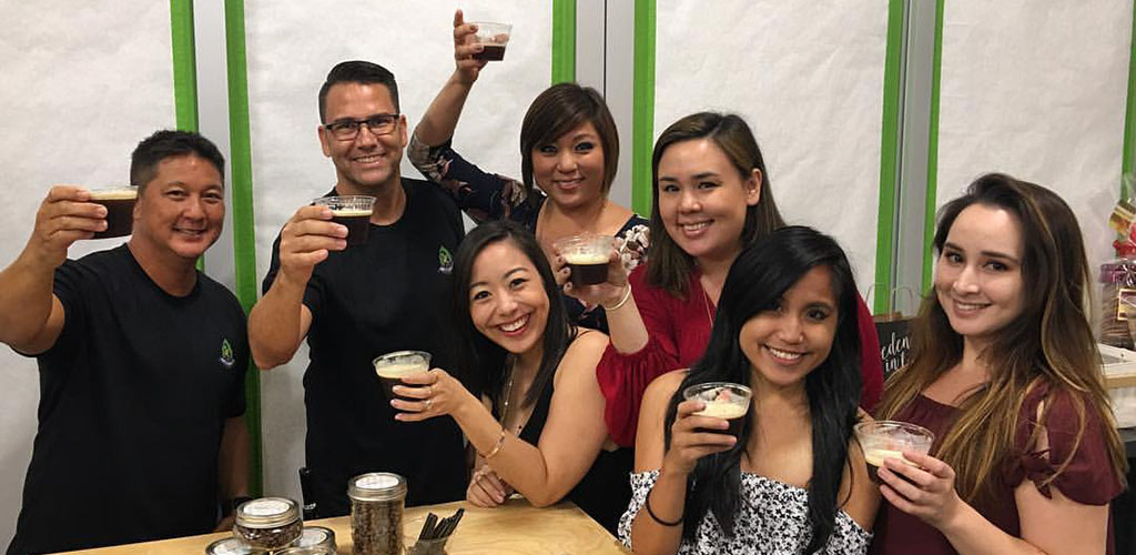 Friends sampling coffee brews at Ali'i Coffee