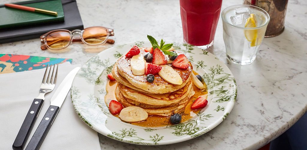 A stack of fruit pancakes from Bill's Restaurant