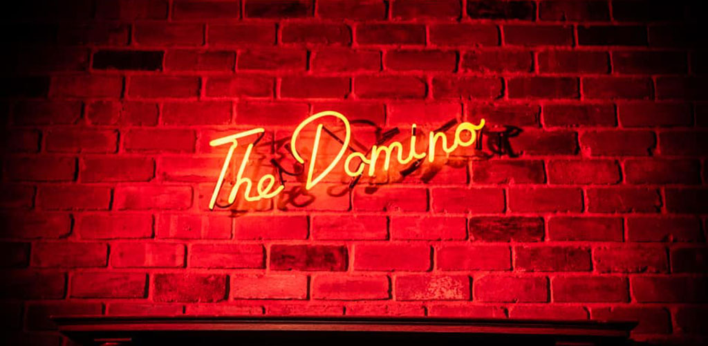 The elegant neon sign of The Domino