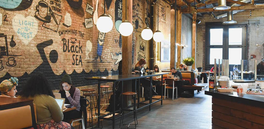 The rustic brick interiors at La Colombe Coffee