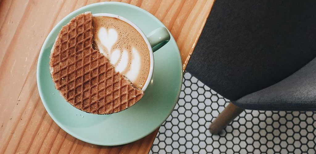 A stroopwaffel over a latte from Little Sister Coffee Maker