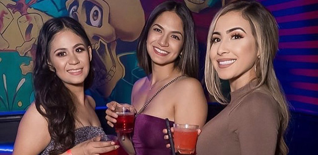 Single girls grabbing drinks at Mezcal Nightclub in Riverside while perusing the crowd for possible hook ups