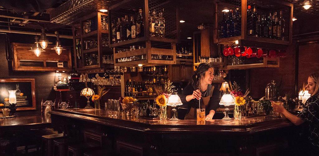 The elegantly lit bar area of The Blind Rabbit