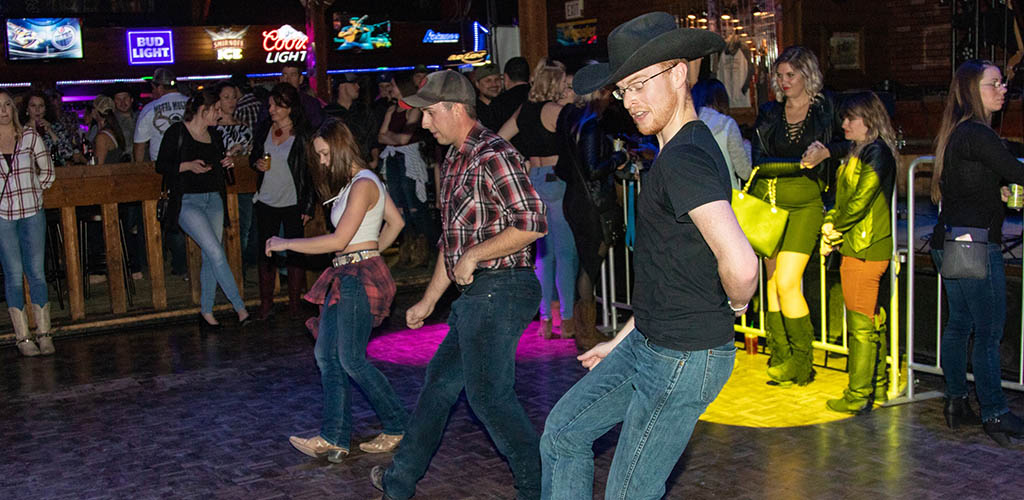 Line dancing at Cook County Saloon
