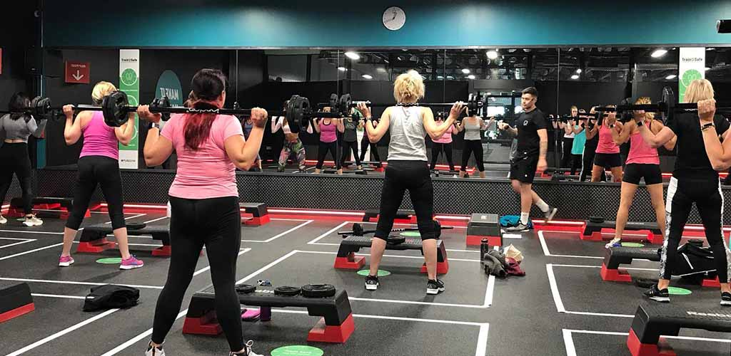 Women working out and mingling at Pure Gym in Leeds