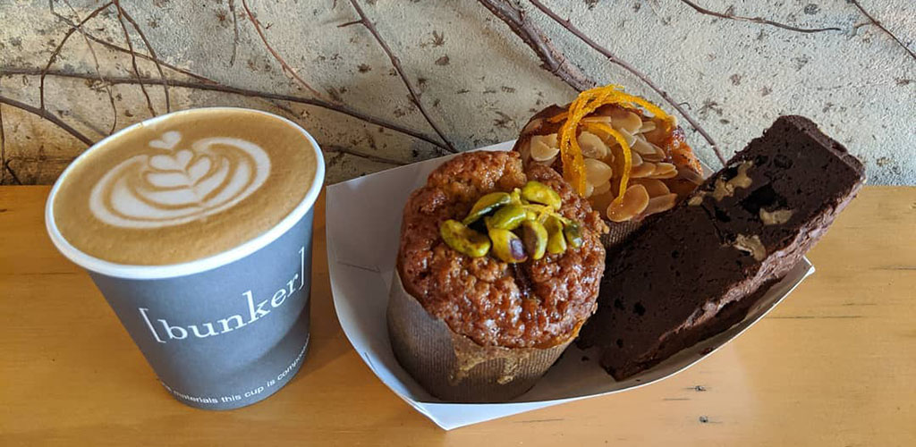 A latte and pastries from Bunker Coffee