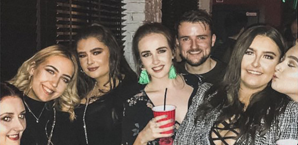 Friends having drinks at Santa Chupitos