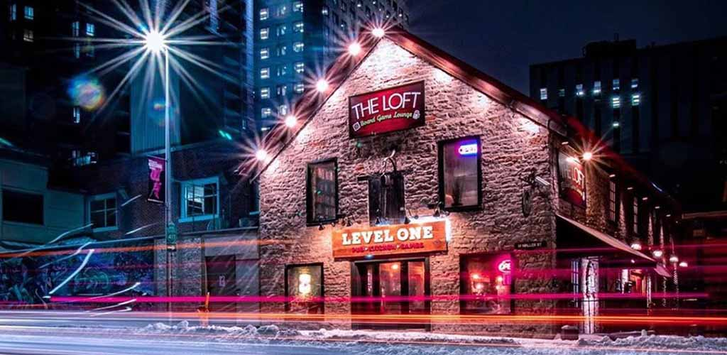 Exterior of Level One Game Pub at night