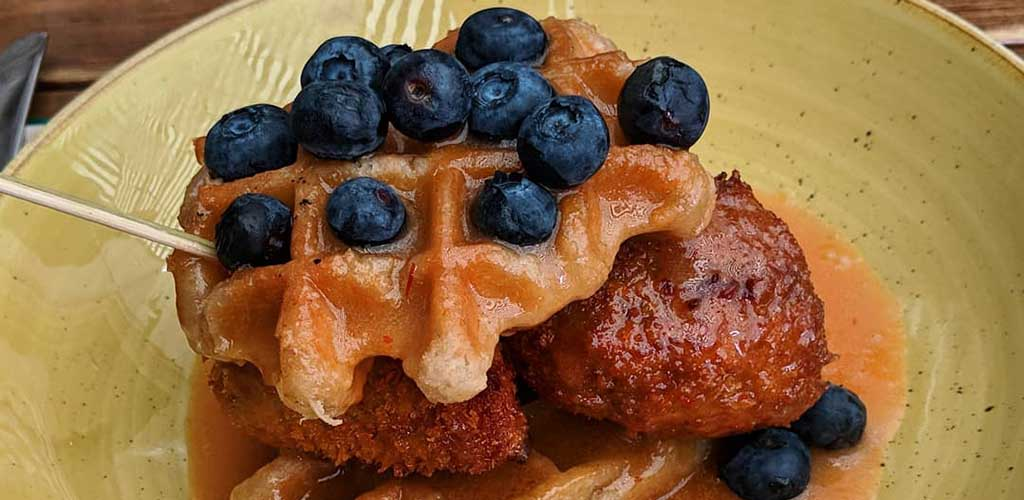 Chicken and blueberry waffles from Restaurant La Buche