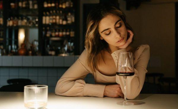 Single girl sitting alone