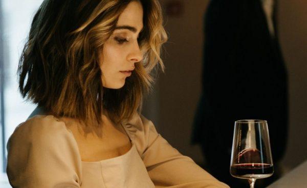 Good looking blonde woman drinking