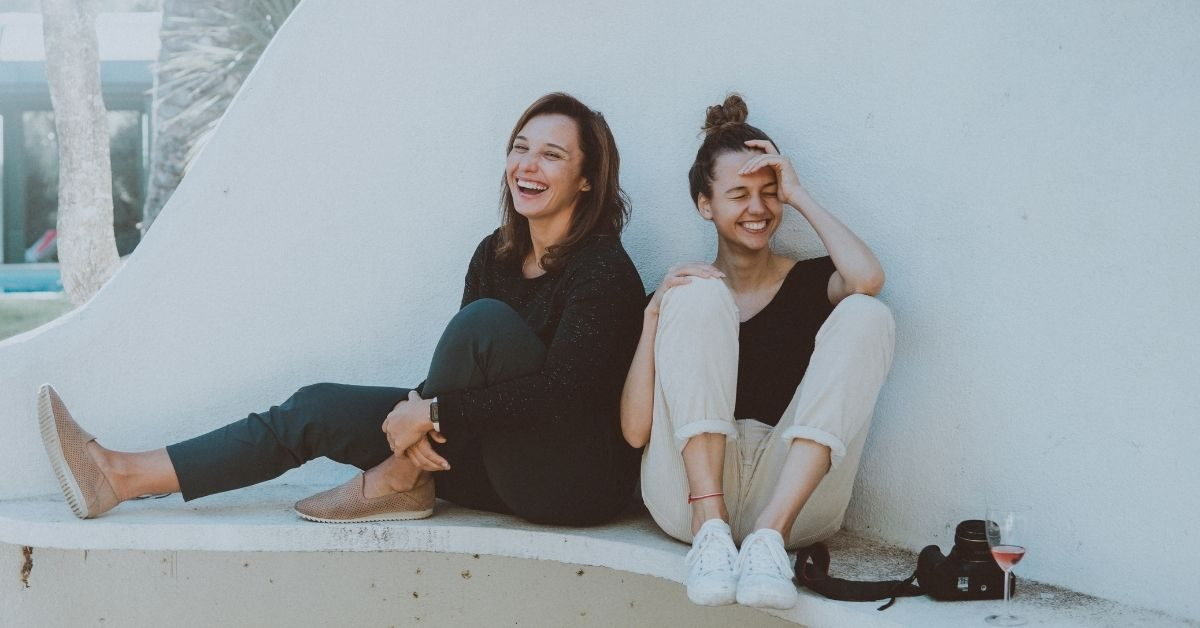 Two women being told a good story