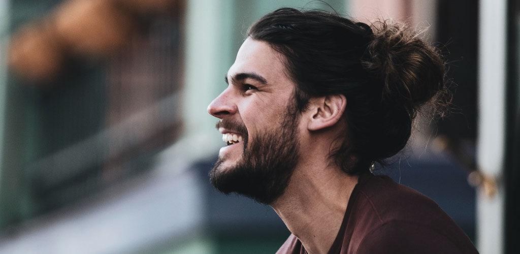 A bearded man with a man bun