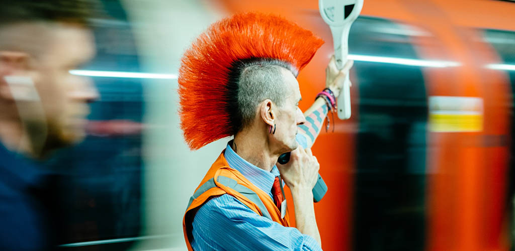 A man with red spiky hair
